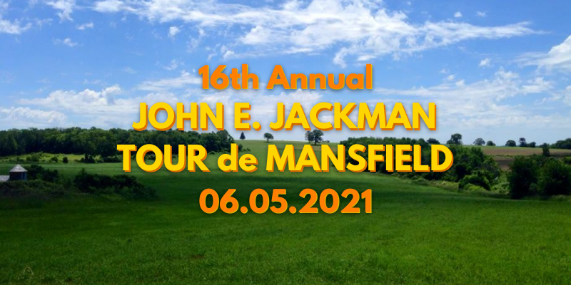 Rolling hills with a partially cloudy sky and the words John E. Jackman Tour de Mansfield 06.05.2021