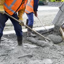 Builders pouring cement during Upgrade to residential street